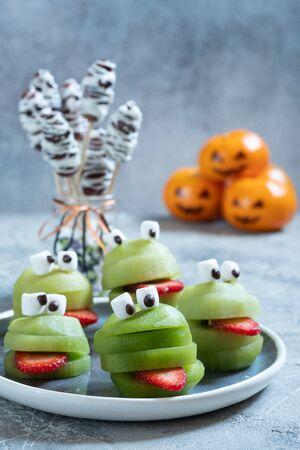 Spooky green kiwi monsters for Halloween