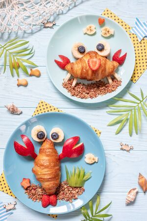 Cute crab croissant with fruit for kids breakfast