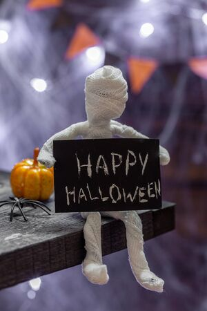Cute funny mummy. Halloween decoration on a table Stock fotó