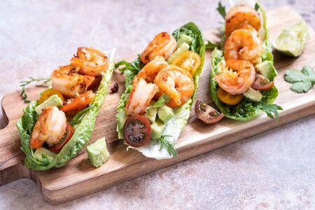 Lettuce wrapped Shrimp tacos with fresh tomato and avocado