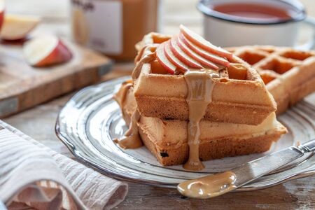Waffles with peanut butter and apple