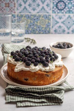 Fresh cakes with blackberries