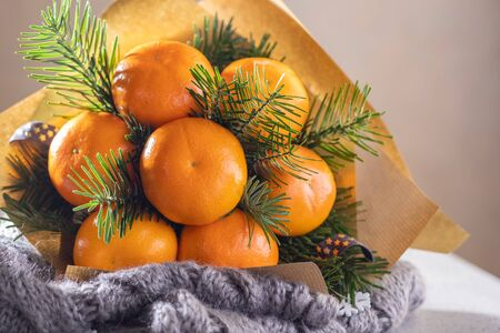 Handmade fruit bouquet of mandarin and Christmas tree branches