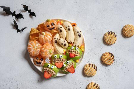 Healthy Halloween Treats. Banana Ghosts, Clementine Orange Pumpkins and Apple Monster Mounts