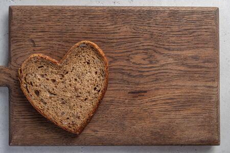 heart shaped slice of brown bread Reklamní fotografie