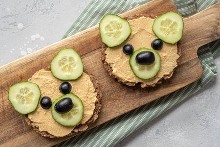 Funny bear toast with cucumber and hummus toasts