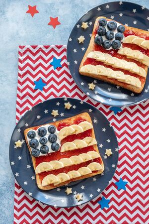 American flag toast with banana, strawberry jam and blueberry
