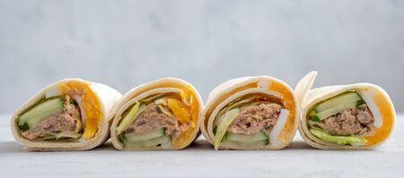Tuna melt wrap with egg, cucumber and salad