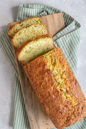 Fresh zucchini bread on a wooden board