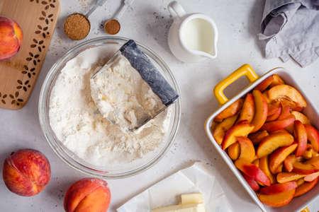 Ingredients for peach cobbler pie