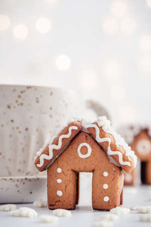 Mini gingerbread house on white Stock Photo