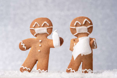 Christmas gingerbread men with a masks