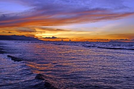 Sunset, sea, mountains, rainforest photo