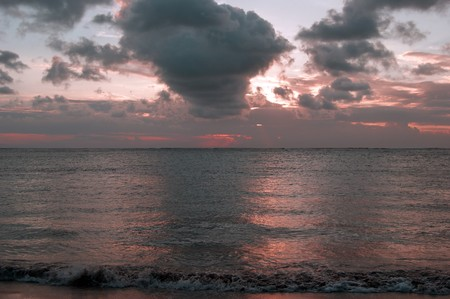 kuta: Sunset at coast Bali about the city of Kuta. Stock Photo