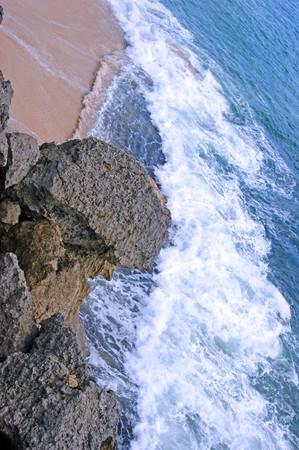 Rocky coast of island Bali about a temple of Uluwatu photo
