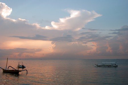 Beautiful sunrise on the bank of coast of the city of Sanur to Bali. photo