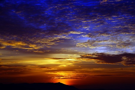 Sunset with a kind on mountains Matang from height of the bird's flight. Malaysia. Borneo. Kuching. Stock Photo - 7456284