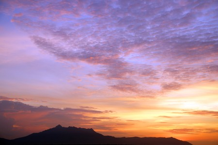 Sunset with a kind on mountains Matang from height of the birds flight. Malaysia. Borneo. Kuching. photo