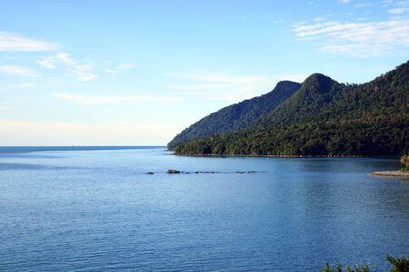 Coast of peninsula Santubong with a view of the sea and mountain Santubong.   Stock Photo