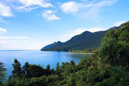 Coast of peninsula Santubong with a view of the sea and mountain Santubong.   photo