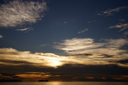 Landscape of natural sandy beaches of coast Southern - the Chinese sea of peninsula Seantubong to Borneo. Sunset.