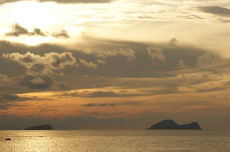 Sea sunset at coast of peninsula Santubong. Borneo.