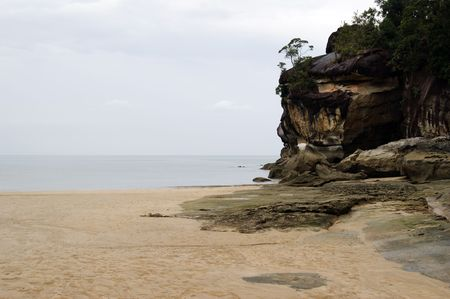 The dark blue sea of the stony coast which have grown with jungle of peninsula Bako. Borneo.