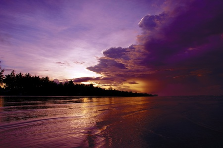 stony: Sea sunset at stony sea coast of Rambungan. Borneo.  Stock Photo