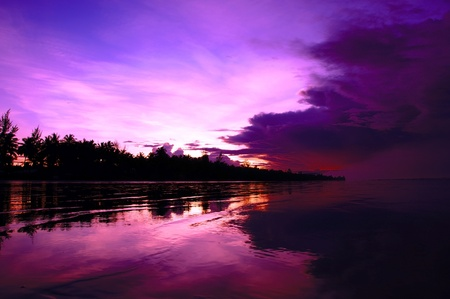 Sea sunset at stony sea coast of Rambungan. Borneo.  Stock Photo