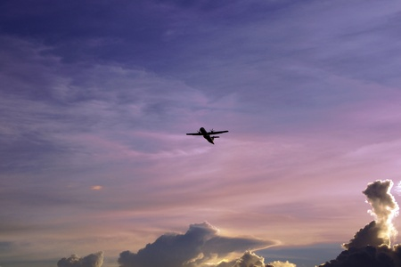 The plane flies in the equatorial sky of paradise island Borneo. Stock Photo