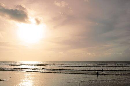 Hot South China sea washes coast Borneo