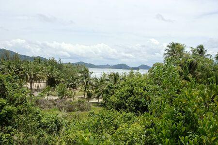 The sea of the coast with jungle of peninsula Santubong. Borneo.
