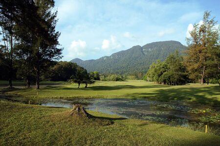 Blue mountain lake in mountainous jungle of island Borneo photo