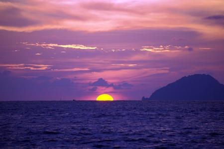 Sea sunset at seacoast of peninsula Santubong. Borneo.  photo