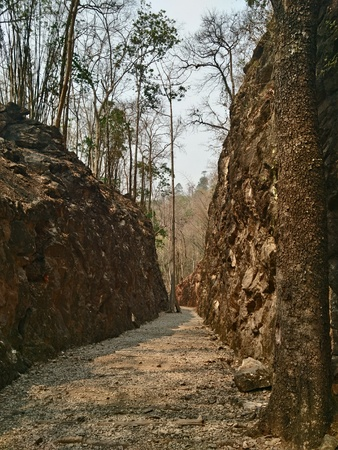 hellfire: Hellfire Pass is the name of a railway cutting on the former Death Railway in History Nation Park that a tourist attraction of Thailand. Stock Photo