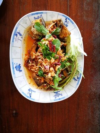 Deep fried spicy Snakehead Fish running in garden in Thai food Standard-Bild - 104206980
