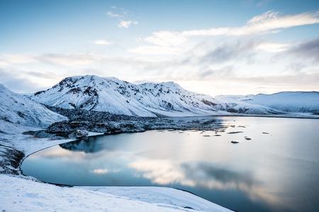 crevasse: Beautiful highland iceland blue lake near Hekla among snow mountains.