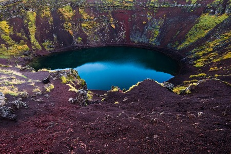 Kerid is a beautiful highland iceland blue volcanic crater lake. Stock Photo