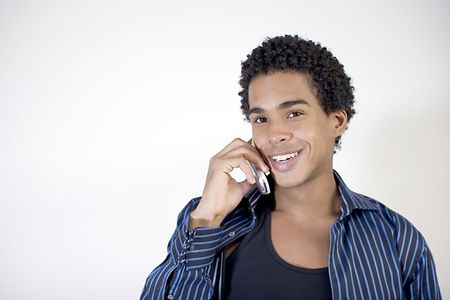 Attractive young man talking on a cell phone photo