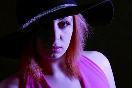 Fashion Hat (extreme lighting, pink gel) Stock Photo