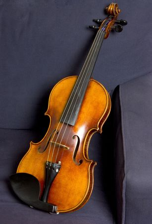 Violin reclining in chair