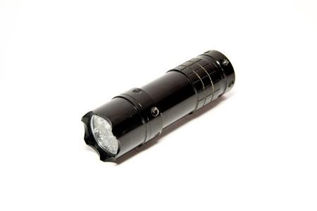 Metal used flashlight isolated on white photo