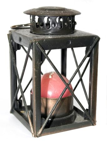 old lamp with red candle and white background