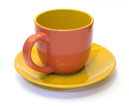 glazed pottery coffee cup and saucer with white background  Stock Photo