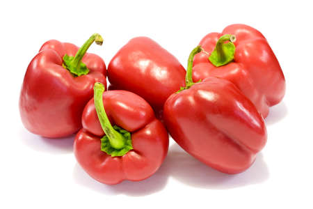 Red sweet bell peppers on white background