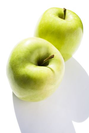 Green apples with shadow on white background