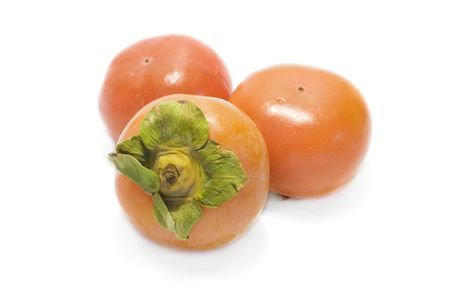 persimmon tree: fresh date-plums with white background