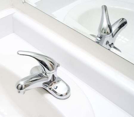 American wash-bowl with mirror in white gamma  Stock Photo