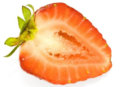 Macro close-up of half-cut strawberry on white background Stock Photo