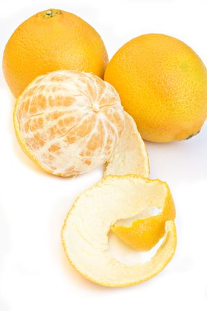 Still Life composition with partially peeled, parted and untouched tangerines with white background